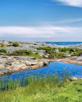 Pölar vid havet – fotografi av Sanning Arkitekter